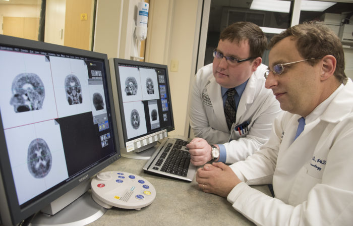 Study authors Beau M. Ances, MD, PhD, (right) associate professor of neurology at Washington University School of Medicine in St. Louis, and Matthew R. Brier, an MD/PhD student at the university, examine PET (positron emission tomography) scans of Alzheimer's disease patients.