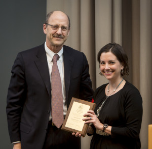 David H. Perlmutter, MD, executive vice chancellor for medical affairs and dean of the School of Medicine, awards Kelly R. Monk, PhD, the Distinguished Investigator Award.