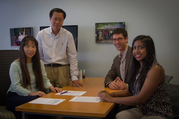 From left, senior author Li Ding meets with study co-authors Feng Chen, Matthew Bailey and Sohini Sengupta.