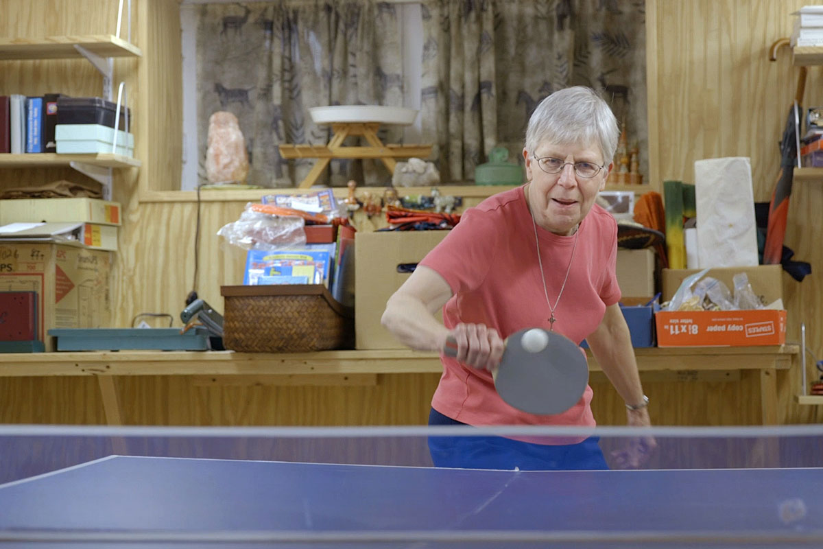 Sister Barbara Schlatter of St. Louis plays table tennis at her home. She participates in a long-term study of adult children of Alzheimer's patients. The study is led by Washington University School of Medicine in St. Louis.