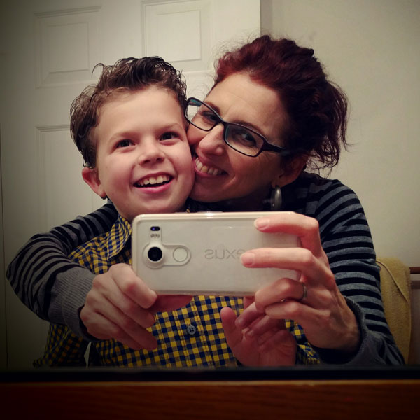 Carmen Valero-Aracama and her son, Luca, smile for a selfie.