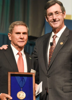 Ralph G. Dacey, Jr., MD (left) receives the Cushing Medal from AANS then-president H. Hunt Batjer.
