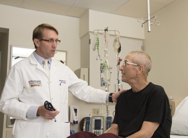 New research led by Washington University School of Medicine in St. Louis shows that patients with acute myeloid leukemia (AML) whose cancer cells carry TP53 mutations — a feature that correlates with an extremely poor prognosis — may live longer if they are treated with decitabine, a less intensive chemotherapy drug. The study's first author, John Welch, MD, PhD, is pictured with Phillip Houghton, who is being treated for AML.