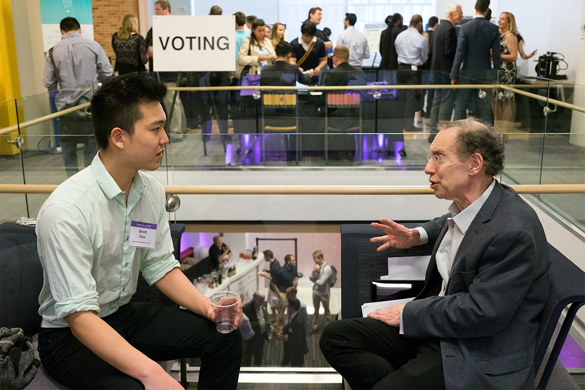 "Brett Gao, an undergraduate student in biochemistry and engineering, talks with well-known entrepreneur Robert Langer, of MIT, before Langer's keynote speech at the IDEA Labs ""Demo Day"" event April 25."