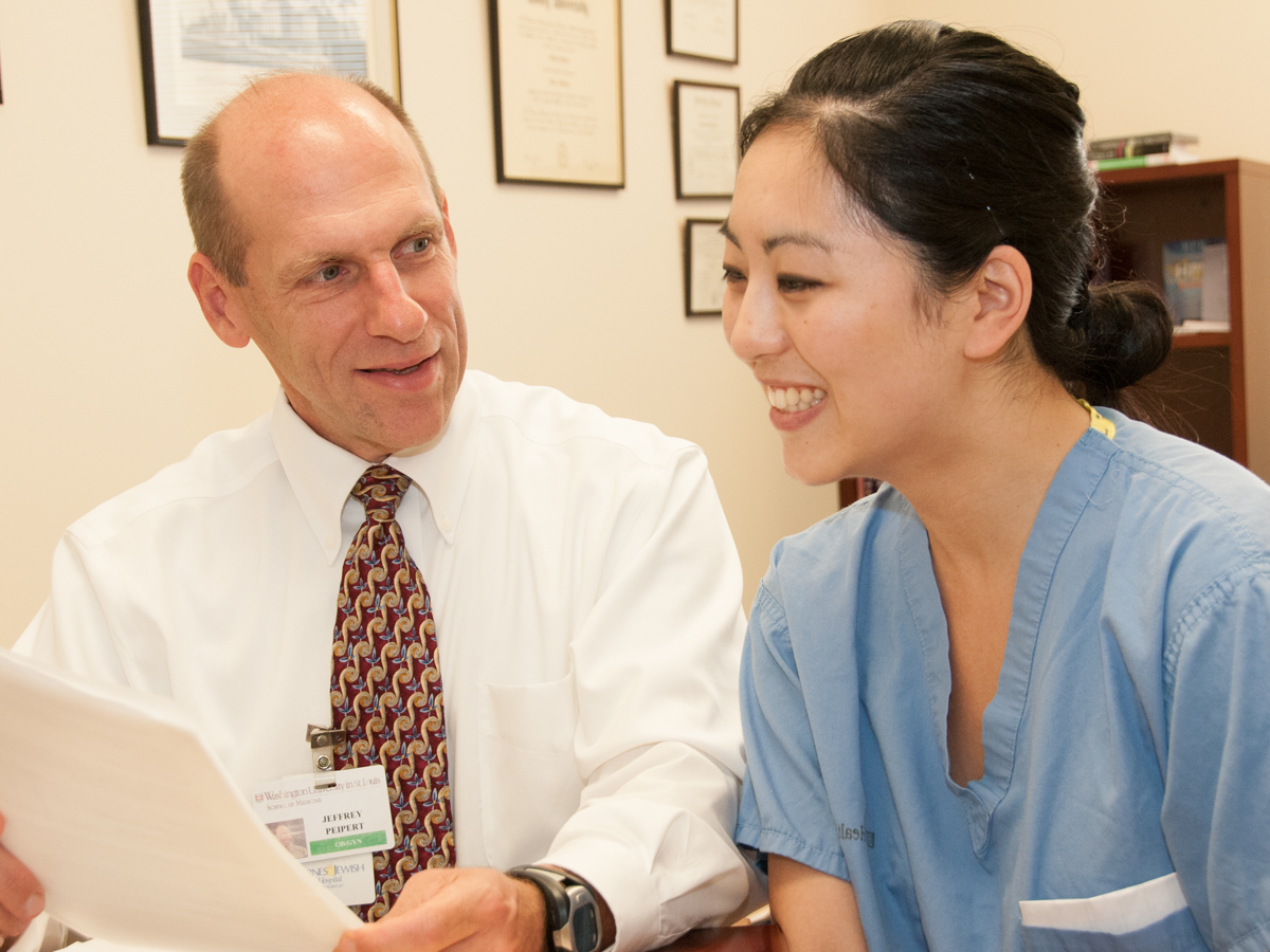 Jeffrey Peipert, MD, PhD (left) with resident Lindsay Kuroki, MD. Peipert leads a study showing free contraception reduces unplanned pregnancies.