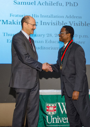 Perlmutter (left) congratulates Achilefu after Achilefu was named the inaugural Michel M. Ter-Pogossian Professor of Radiology.