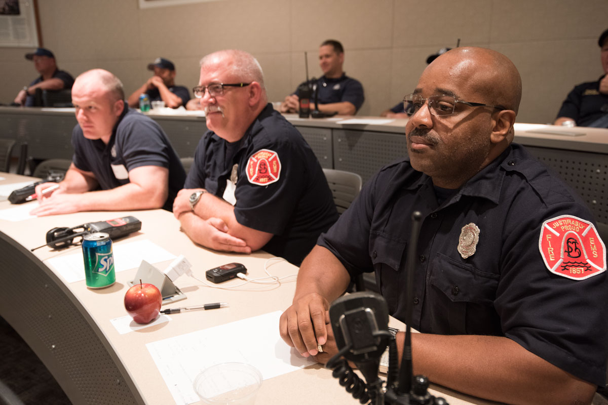 St. Louis city firefighters participate in a training session on the Medical Campus. In the front row are (from left) Patrick Hecht, Robert Komorowski and Calvin Stewart.