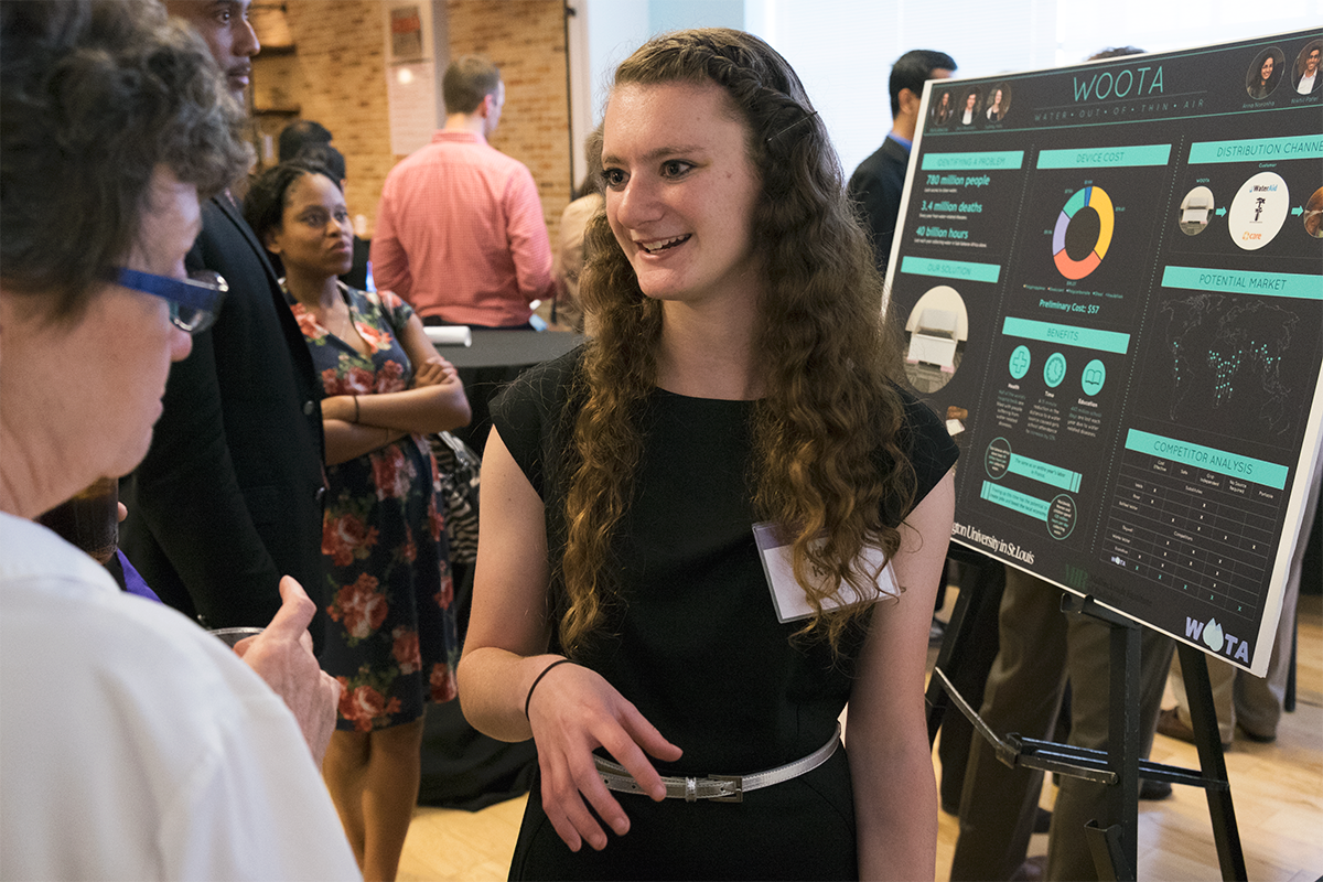 "Sydney Katz, an undergraduate student in electrical engineering, talks with IDEA Labs ""Demo Day"" participants about her team's technology, which aims to alleviate the clean-water crisis in developing countries."