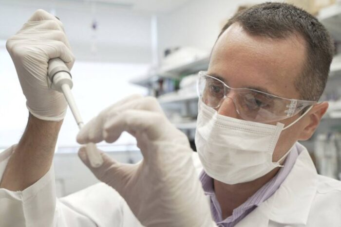Researcher Nicolas Barthelemy works on a p-tau217 test for Alzheimer's disease at a laboratory.