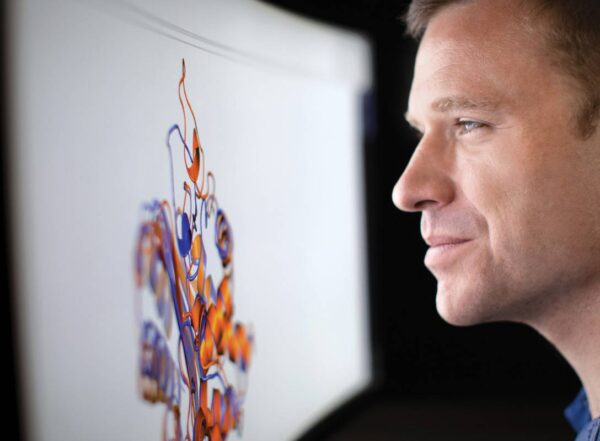 Greg Bowman, PhD, views a highly magnified protein on his computer screen.