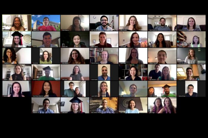 Screenshot of a Zoom call shows a grid of 32 smiling students ready to graduate
