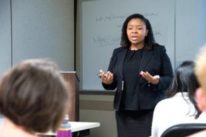 A facilitator leads a diversity training session