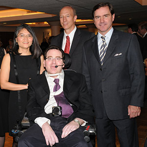 Jason S. Goldfeder, MD, is flanked by (from left) his wife, Nguyet Nguyen, MD; David Holtzman, MD, head of the Department of Neurology at Washington University; and Toby Martin, CEO of NAI DESCO, at the 2012 Evening of Hope, an event held by the organization Hope Happens for Neurological Disorders. Goldfeder was honored at the event with the Spirit of Hope Award. Photo: Reprinted with permission from L. Strauss / Ladue News