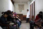 Angel Velarde, MD, research director at the Instituto Nacional de Cáncerologia (INCAN), stops in a hallway to speak with patients waiting for radiation therapy. Patients are treated on a first-come, first-served basis and waiting rooms quickly fill up.