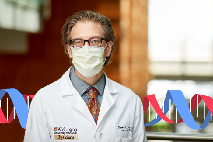 Dr. Steve Lawrence poses for a portrait wearing his white coat and a face mask