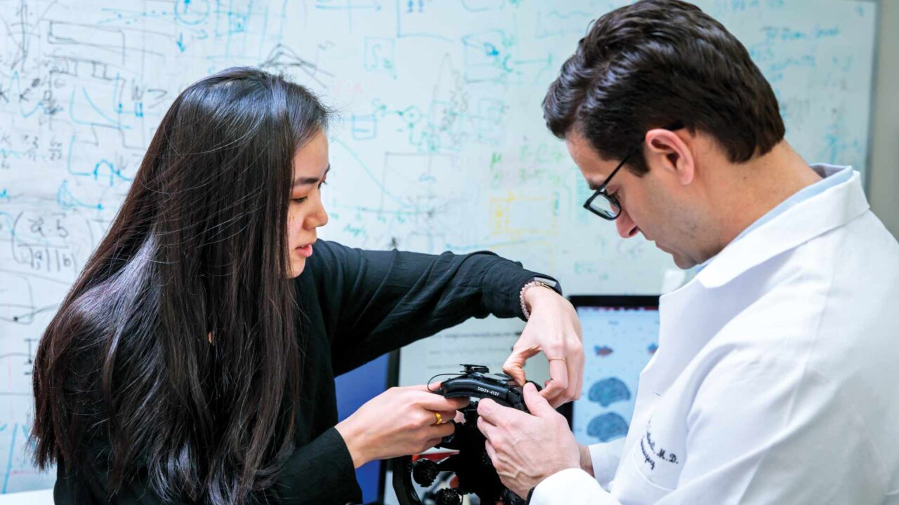 Eric Leuthardt, MD, and mentee Sarah Chiang, a first-year medical student, study a portable electroencephalogram (EEG) headset that allows quick and easy neural data retrieval from many patient populations.