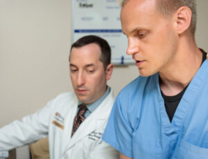 Medical student Weston McCarron (right) and Evan Schwarz, MD