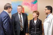 Rodger and Paula Riney, center, greet John DiPersio, MD, PhD, left, and Ravi Vij, MD.