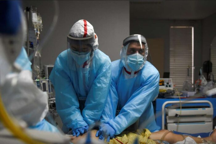 Healthcare personnel perform CPR on a patient inside a coronavirus disease (COVID-19) unit at United Memorial Medical Center