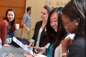 A group of medical students chat at the Student Programs Fair