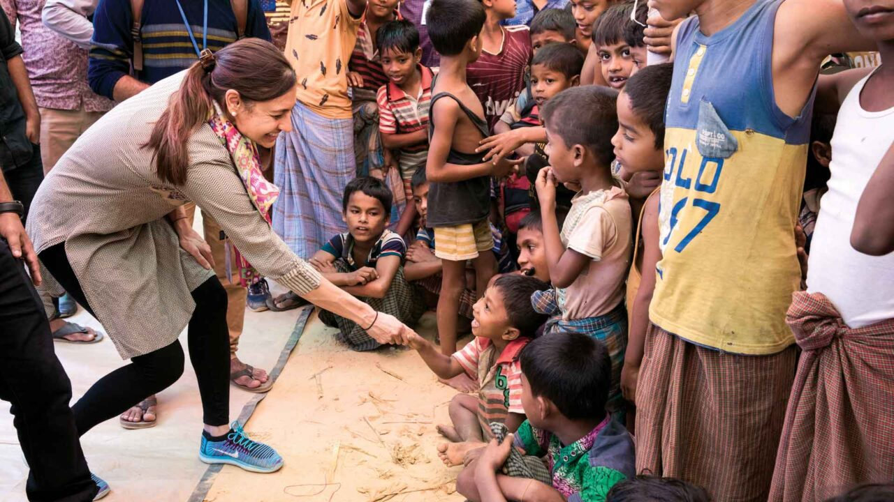 Rupa Patel, MD, MPH, visits with Rohingya children who have come to watch an educational play.