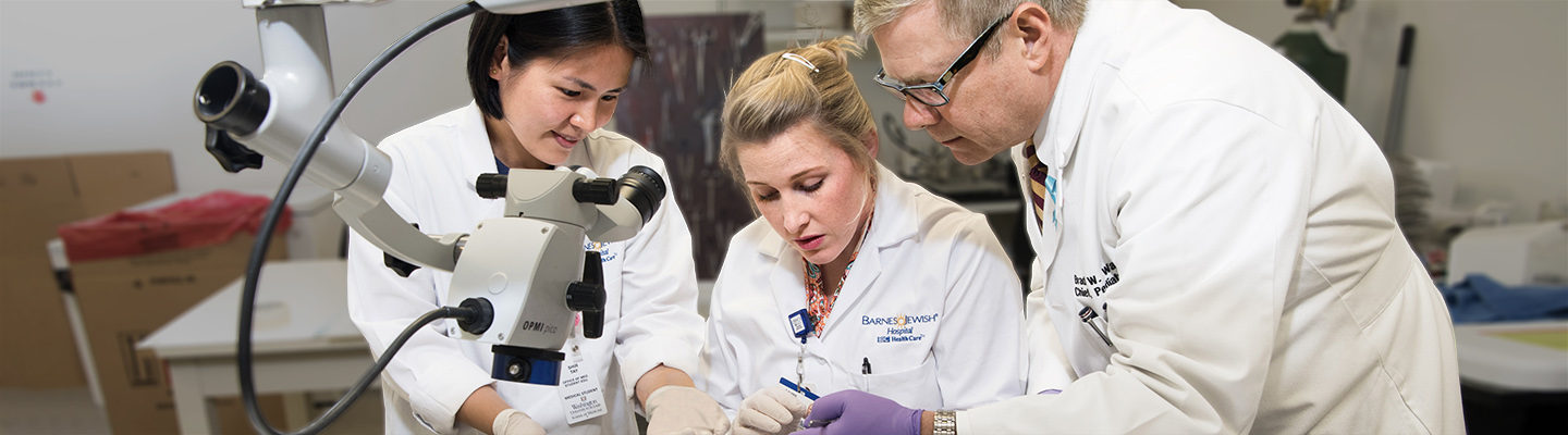 Medical student Sir Tay, surgery resident Lauren Barron and pediatric surgery chief Brad Warner collaborate in the intestinal adaptation laboratory.