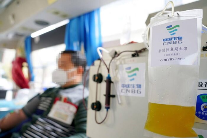A patient in Xingtai, China, who has recovered from COVID-19 donates plasma, the liquid part of blood, which contains antibodies against the coronavirus.