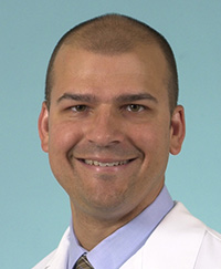 Gastroenterologist Gregory Sayuk, MD, is looking at changes in the brains of patients with irritable bowel syndrome (IBS).
