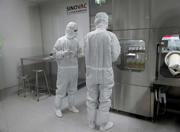 Researchers in full body PPE Inside Sinovac Biotech's factory in Beijing in September.