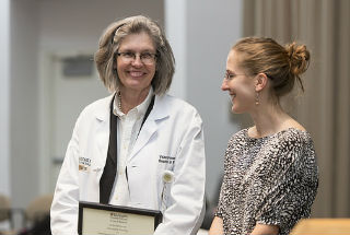 Vicky Fraser, MD, receives an award.