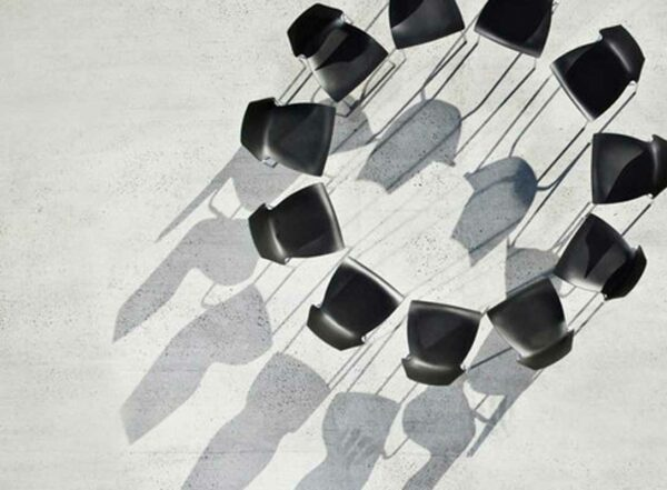 11 black chairs form a circle