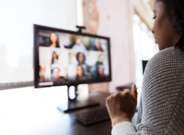 Woman video conferences with co-workers during the pandemic shutdown