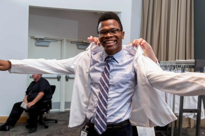 "A new medial student is ""coated"" at the 2017 White Coat Ceremony"