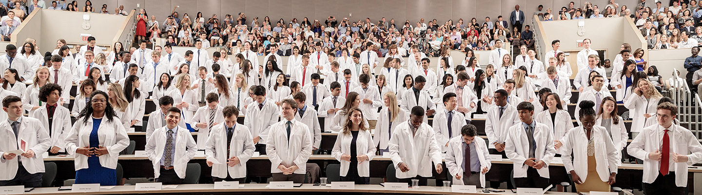 The incoming class of 124 medical students pledges an oath wearing their newly received white coats