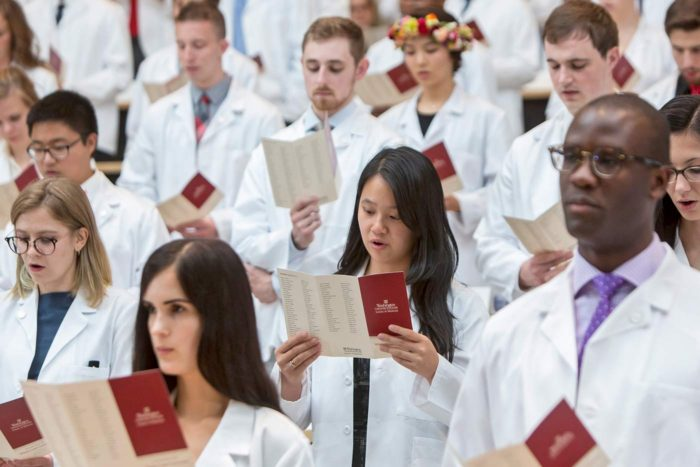 Incoming MD students pledge an oath at their White Coat Ceremony