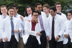 Medical students pose for a photo after the White Coat Ceremony
